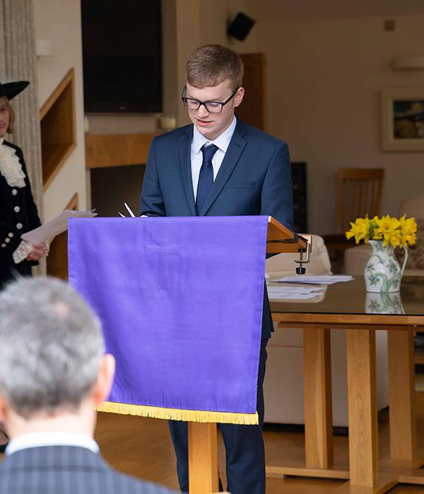 John Barton reading the installation of High Sheriff of Cumbria