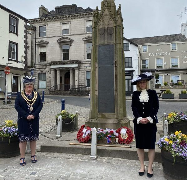 High Sheriff Julie Barton lays flowers at Market Cross VE Day