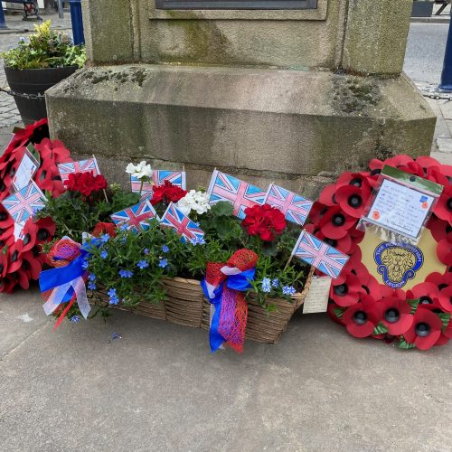VE Day flowers and wreath at Ulverston Market Cross