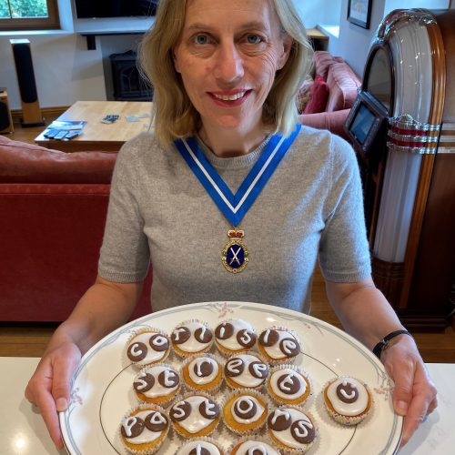 Julie with cakes she has baked
